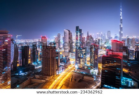 Beautiful night city, cityscape of Dubai, United Arab Emirates, modern futuristic architecture nighttime illumination, luxury traveling concept - stock photo