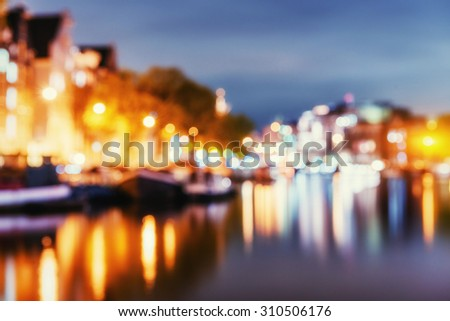 Beautiful night in Amsterdam. Natural blurred background. Soft light effect. - stock photo
