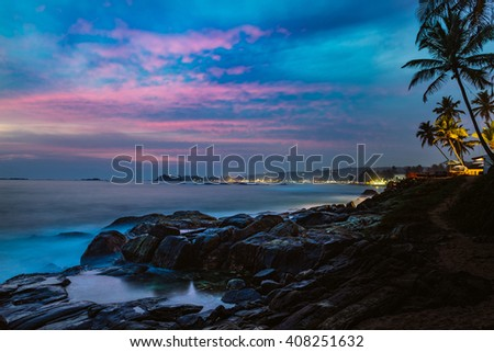 Beautiful night landscape tropical rocky beach. Sri Lanka. - stock photo