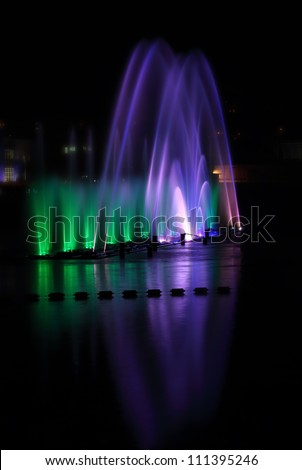 Beautiful night performance of colorful fountains in Vinnitsa, Ukraine