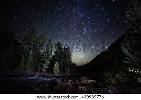 Beautiful night scenery of the stars of the night forest. Milky Way with stars in the Altai Mountains. Siberia. Russia - stock photo