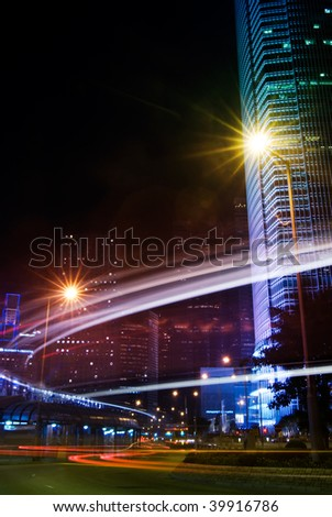 Beautiful night scenes of skyscraper with light and motion blurred of cars in Hong Kong. - stock photo