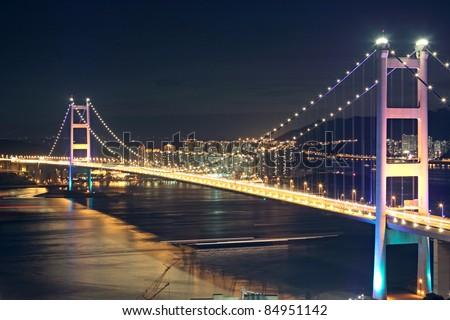 Beautiful night scenes of Tsing Ma Bridge in Hong Kong. - stock photo