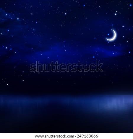 beautiful night sky in the open sea - stock photo