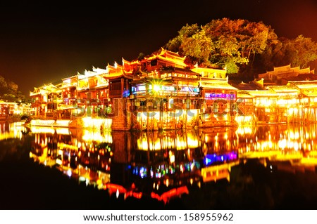 beautiful night view at Fenghuang (Phoenix) ancient town,Hunan province, China - stock photo