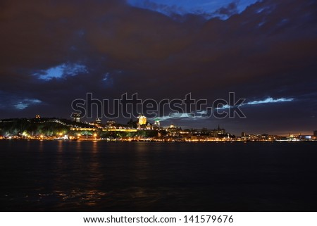 Beautiful night view in Quebec city above Saint Lawrence river in a cloudy spring day. - stock photo