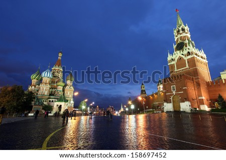 Beautiful Night View of Intercession Cathedral (St. Basil's) and the Spassky Tower of Moscow Kremlin at Red Square in Moscow, Russia - stock photo