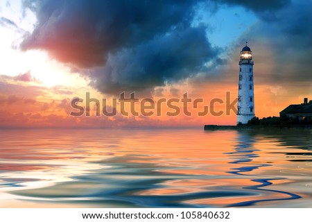 Beautiful nightly seascape with lighthouse and moody sky at the sunset - stock photo