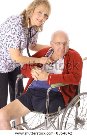 beautiful nurse checking elderly patient - stock photo