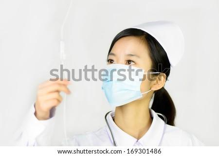 Beautiful nurse on a white isolated background  - stock photo