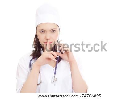 Beautiful nurse represents  silence sign with syringe on white background - stock photo