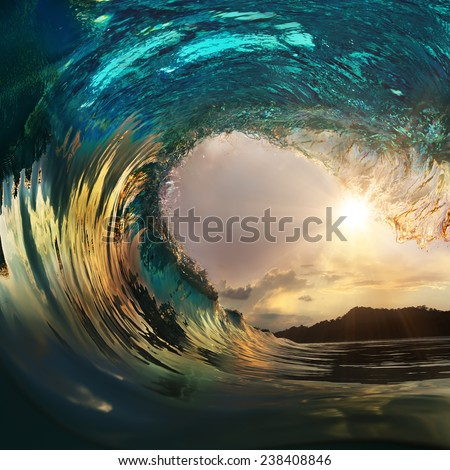 Beautiful ocean surfing wave breaking at sunset beach - stock photo