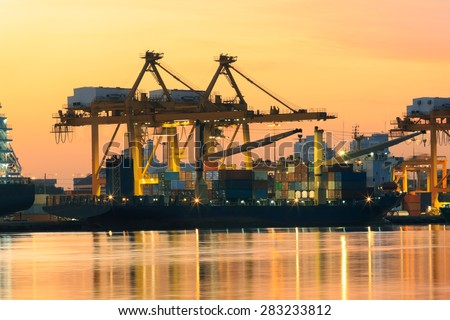 beautiful of morning light in ship port loading container goods in import ,export and logistic transport industry - stock photo