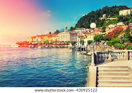 Beautiful old Bellagio town at Como lake, Italy. Summer sunny day. Color filter applied. - stock photo