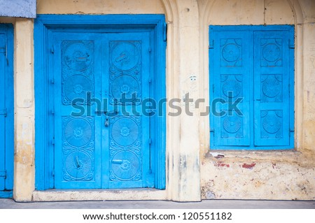 Beautiful old blue gates. Indian architecture. - stock photo