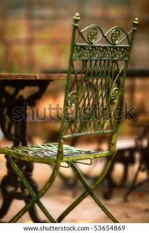 Beautiful old chair in street cafe in Tuscany - soft focus - stock photo