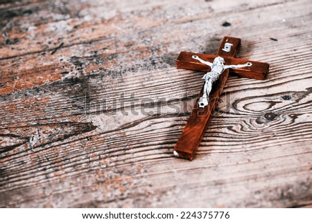Beautiful old cross with jesus on the old wooden floor - stock photo