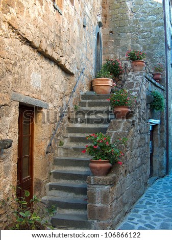 Beautiful, old entrance to a home in the Medieval Italian hill town of Civita di Bagnoregio.