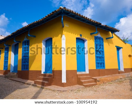Beautiful old house in the colonial town of Trinidad in Cuba, a famous touristic landmark on the caribbean island - stock photo