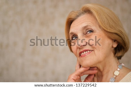 beautiful old lady is resting at home after a hard working week - stock photo