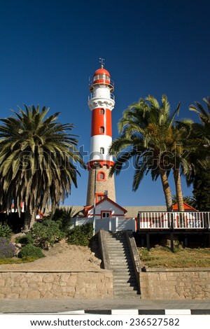 Beautiful old lighthouse and colonial architecture in Swakopmund, west coast of Namibia, Africa - stock photo