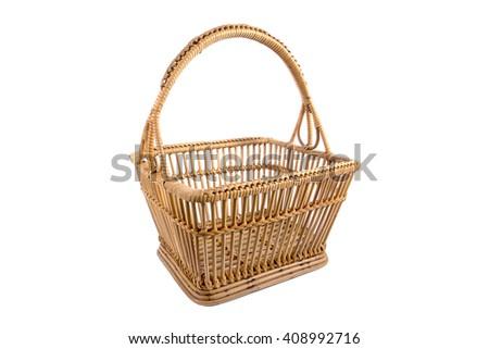 Beautiful old rattan basket isolated on white background - stock photo