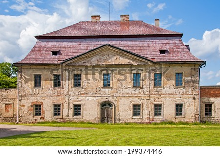 Beautiful old rural house with flaking facade - stock photo
