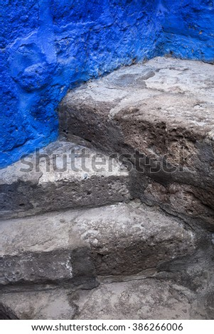 beautiful old steps and blue wall - stock photo