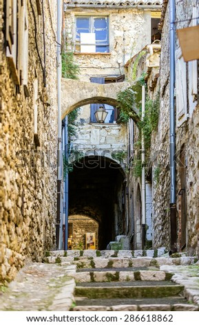 Beautiful old street in the Provence, France - stock photo