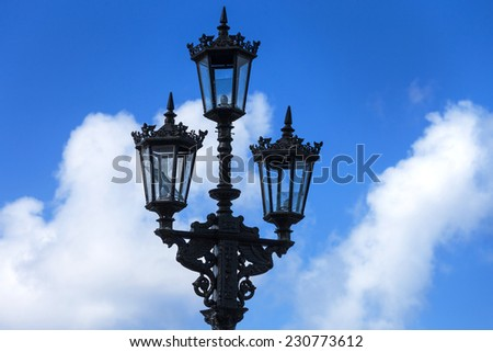beautiful old street lamp in the sky - stock photo