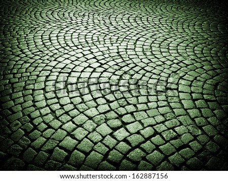 Beautiful old urban cobblestone paved street in France. - stock photo