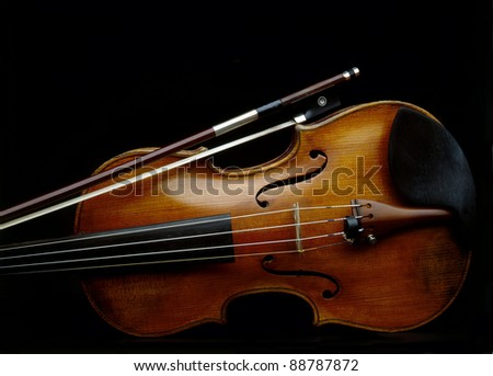 Beautiful old violin on dark background