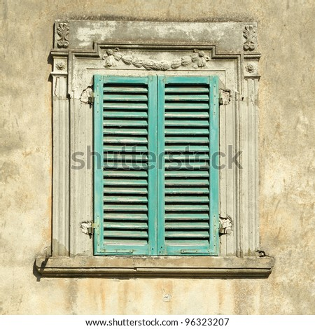 beautiful old window with green shutters, Italy, Europe - stock photo