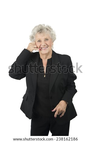 Beautiful old woman doing a telephone gesture with her hand against a white background - stock photo
