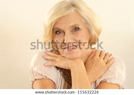 beautiful old woman on a beige background