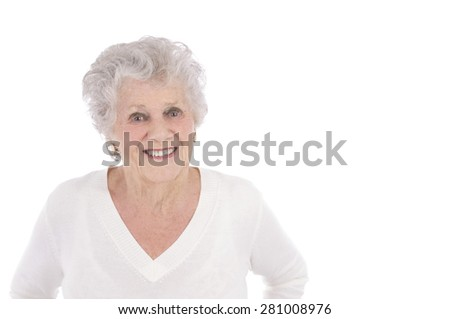 Beautiful old woman smiling against a white background against a white background - stock photo