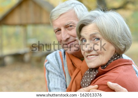 Beautiful older couple walking in the fresh air