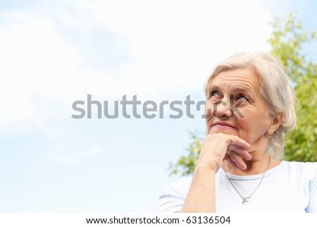 beautiful older woman stands on the sky