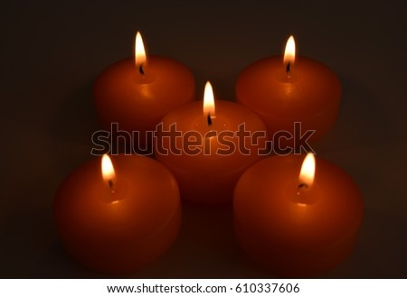 Beautiful orange candles at night