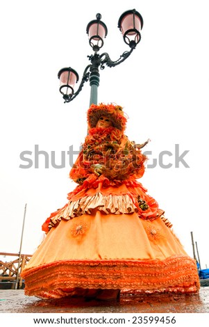 Beautiful orange mask in Venice, Italy. High key image. - stock photo