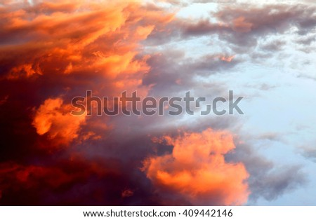 Beautiful orange sky like a painting with sunny clouds - stock photo