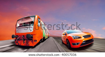 Beautiful orange sport car and train on road - stock photo