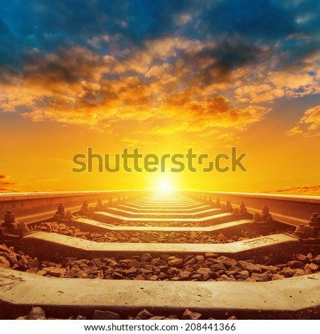 beautiful orange sunset over railroad close up - stock photo