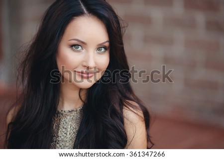 beautiful outdoor portrait. brunette woman with long healthy hair. Beautiful woman face - outdoor portrait. beautiful young woman portrait, close up outdoor - stock photo