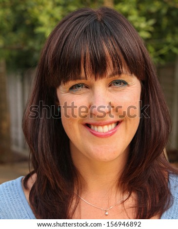 Beautiful outdoor portrait of a stunning middle-aged lady