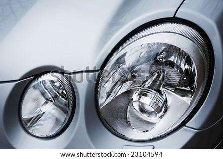 Beautiful oval headlights of the modern car - stock photo