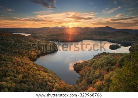 beautiful overlook of Nichols pond in Vermont in the fall - stock photo