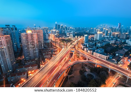 beautiful overpass at the intersection of two viaducts in shanghai  - stock photo