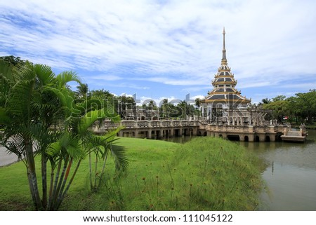Beautiful pagoda on the pond at Chalerm Prakiat park in Nontaburi province, Thailand