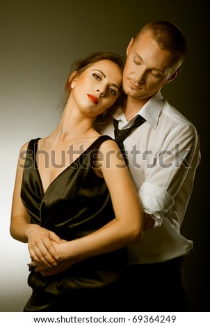 beautiful pair of retro style embraces the studio - stock photo